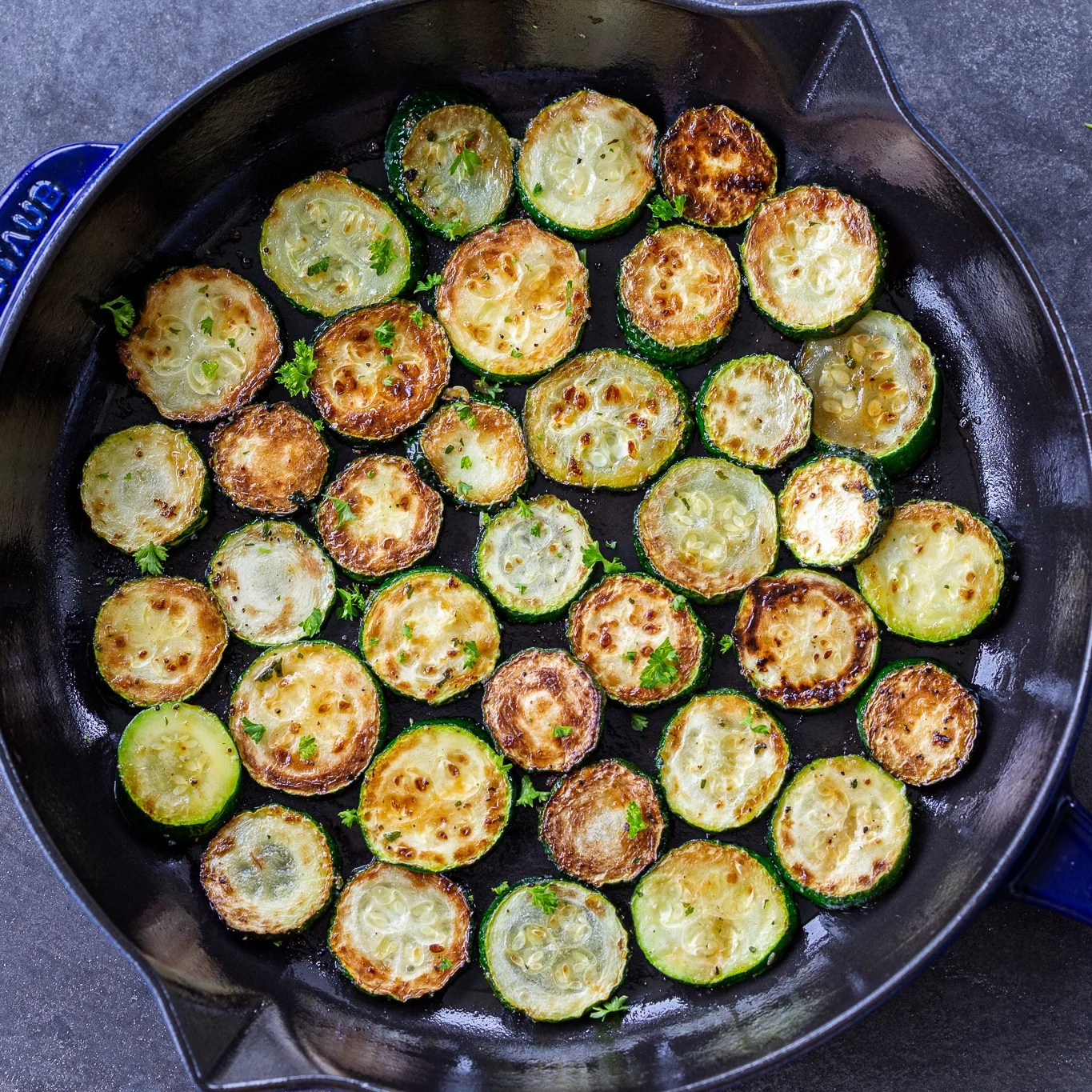 Browned zucchini in a frying pan