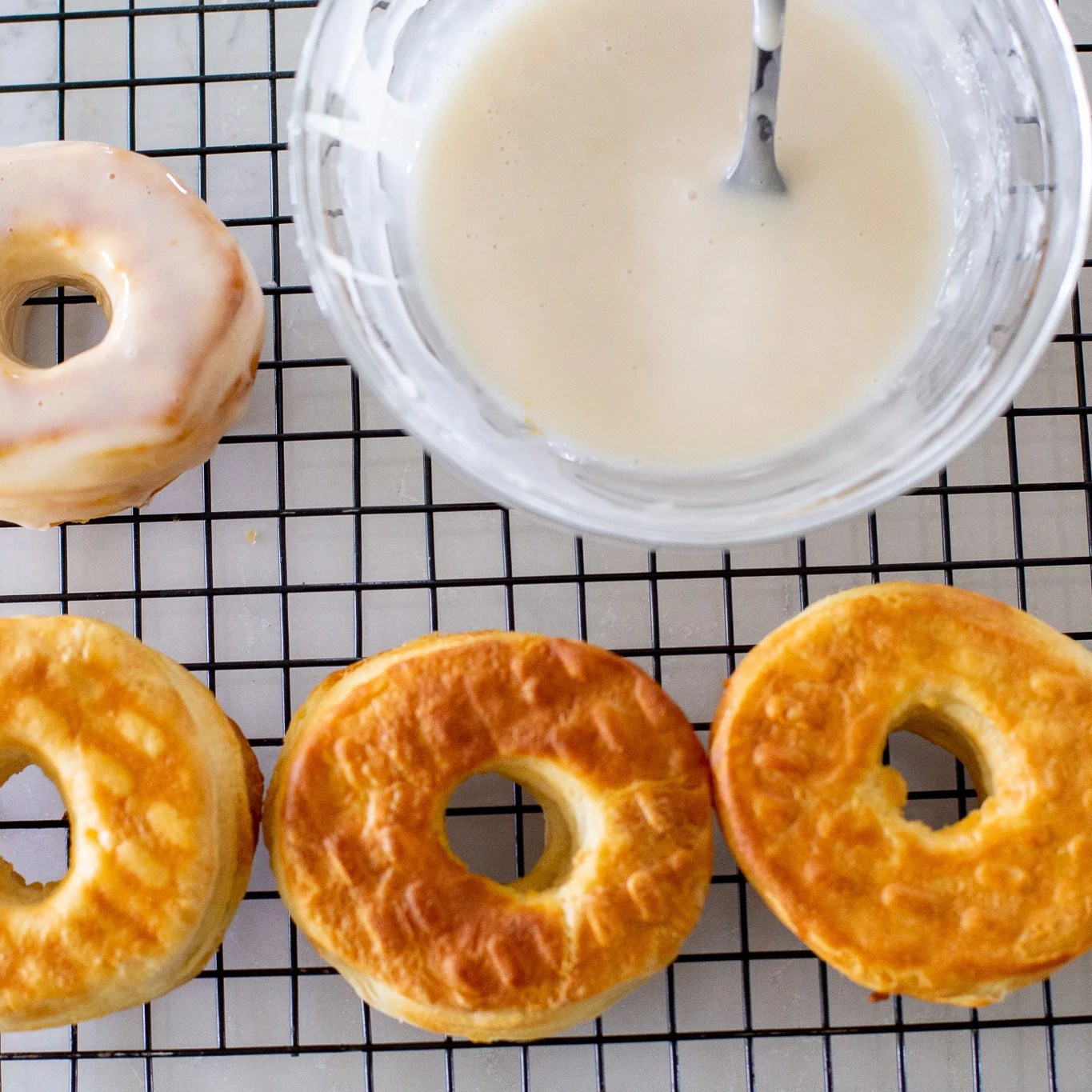 glaze and donuts on a cooling rack