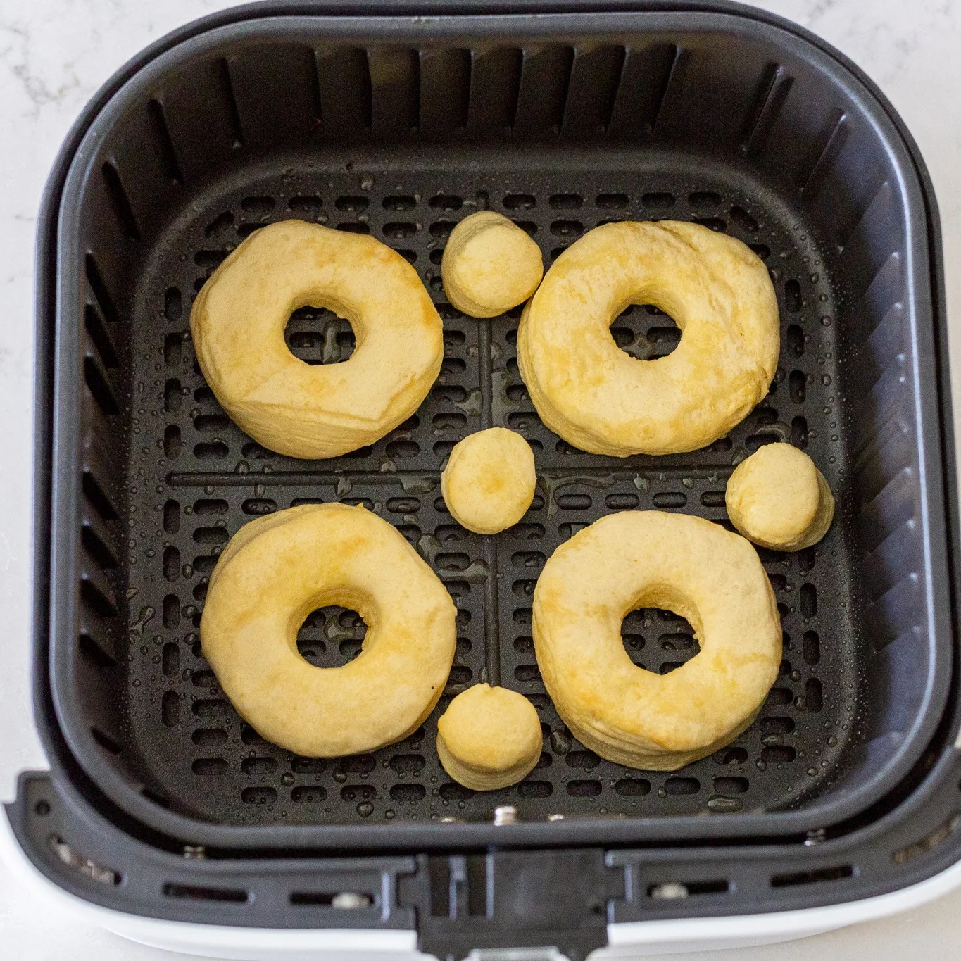 Donuts in an airfryer basket
