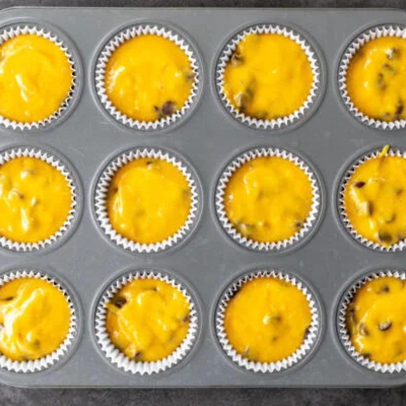 batter in a muffin pan