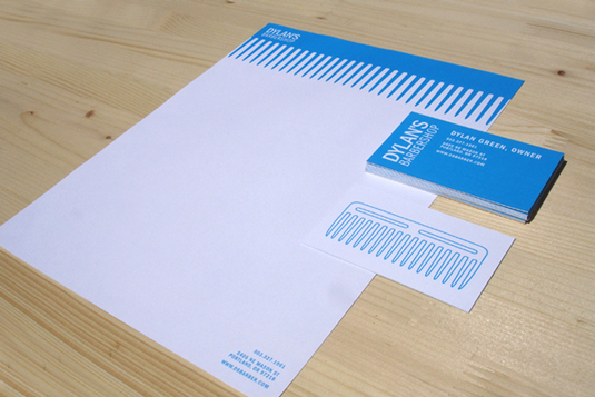 Dylan's Barbershop hass a blue comb graphic as a letterhead