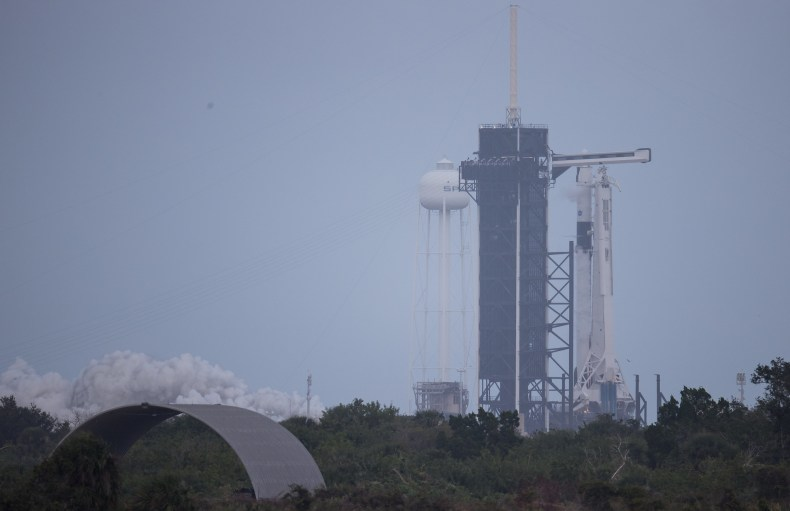 A SpaceX Falcon 9 rocket test fires its first-stage engines briefly atop Pad 39A at NASA's Kennedy Space Center in Cape Canaveral, Florida on Nov. 11, 2020. The rocket will launch the Crew-1 astronaut mission for NASA on Nov. 14.