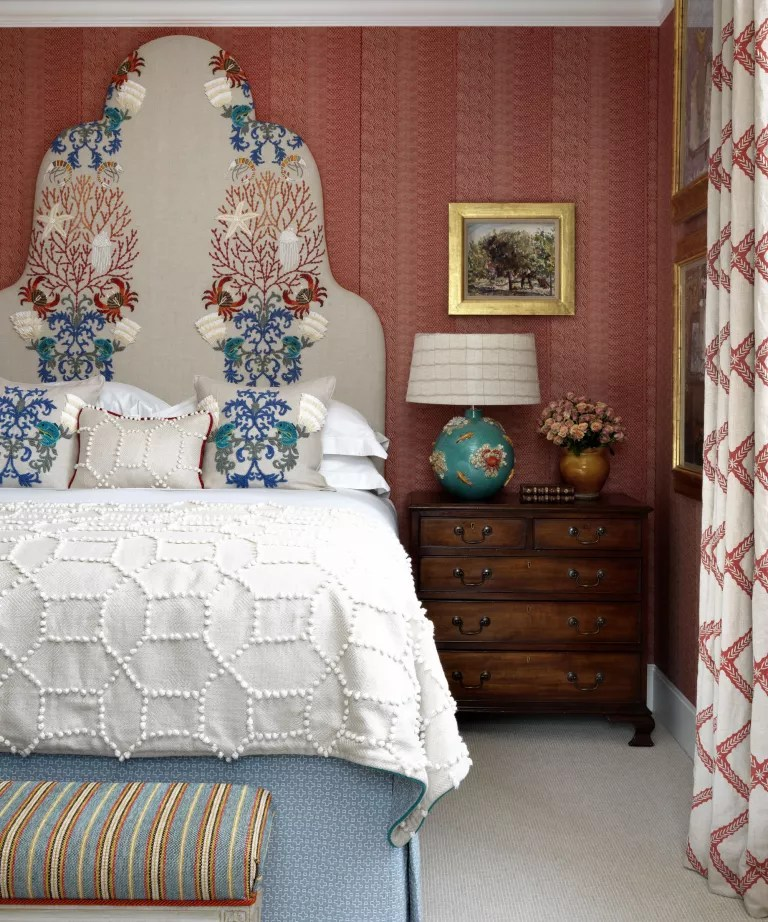 Colorful bedroom with pattern and ornate headboard
