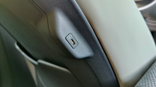 Close-up of a USB-C port embedded on the side of a car seat