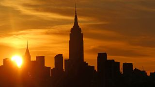 The sun rises behind midtown Manhattan and the Empire State Building in New York City. On the morning of Nov. 11, 2019, Mercury will transit the rising sun.