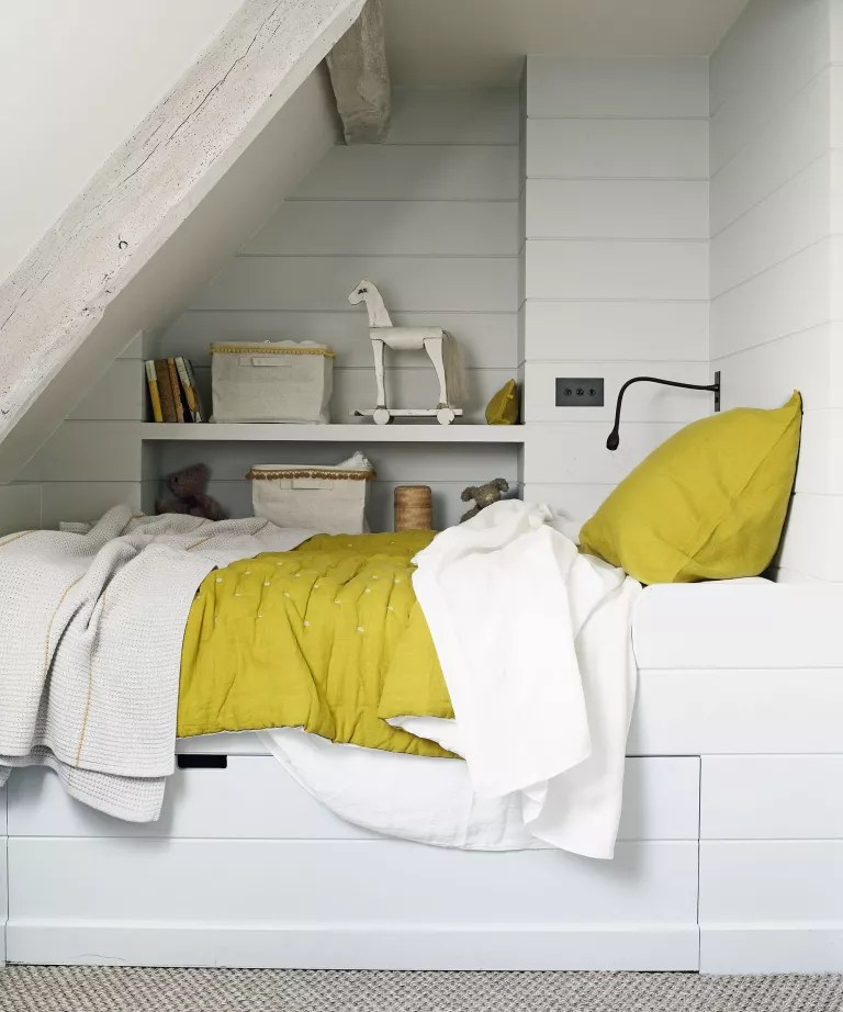Kids loft room with storage bed and shelving