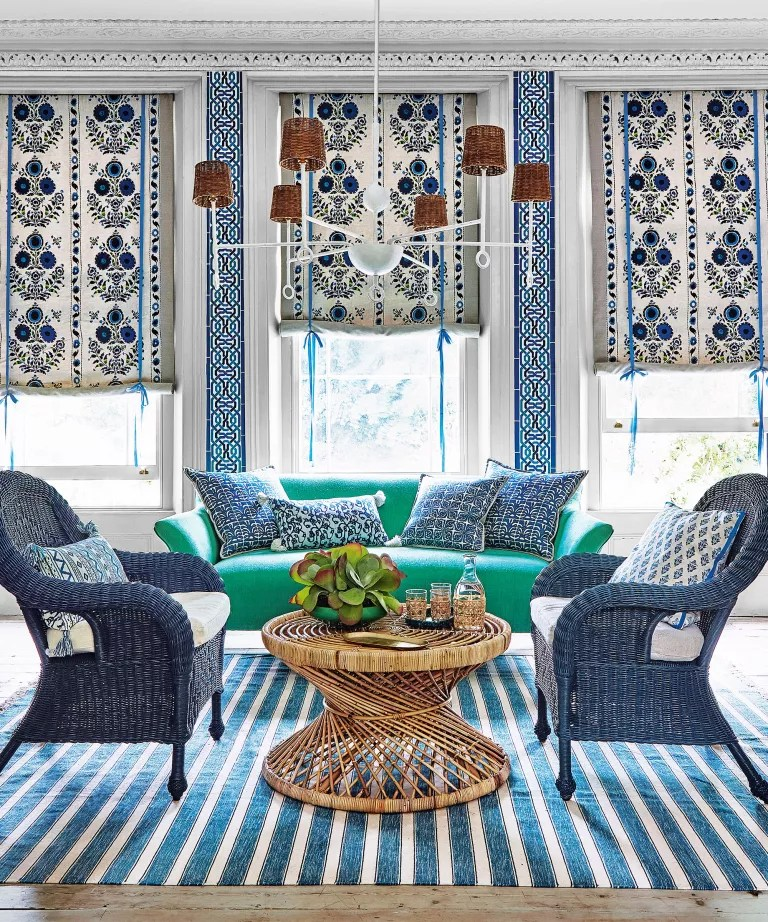 Living room with green sofa and blue armchairs