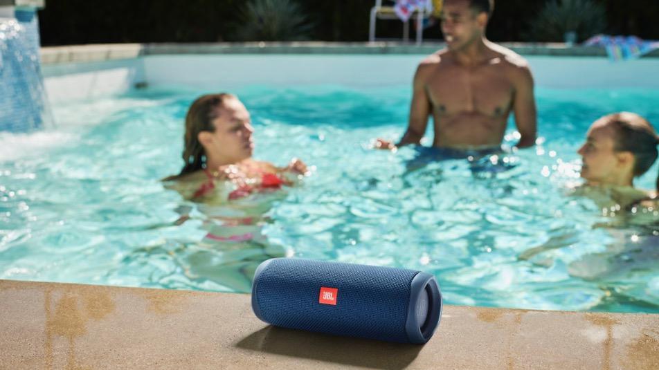 the JBL Flip 5 Bluetooth speaker by a pool