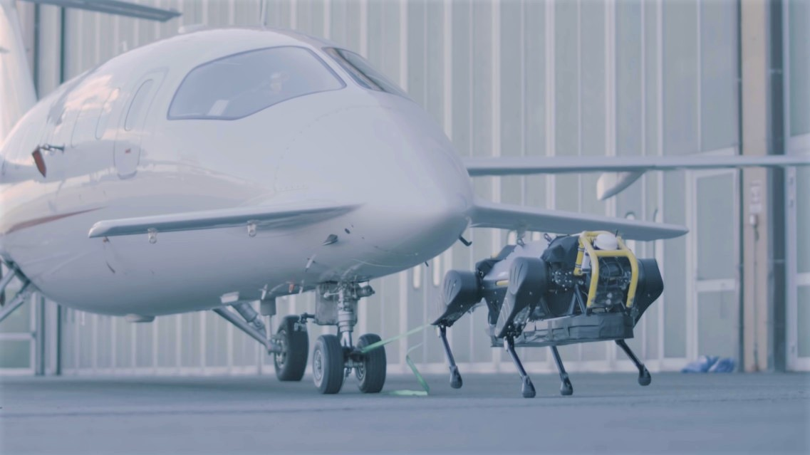Watch this plucky little robot dog pull a three-ton plane 1