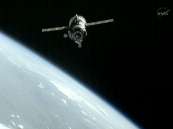 Soyuz Capsule Docks at Space Station with International ...