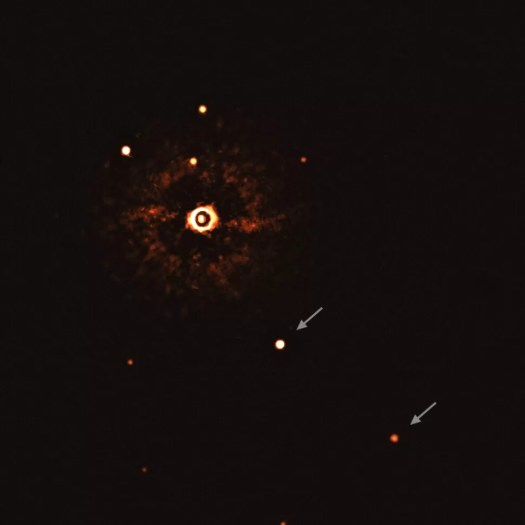 The two giant planets in the TYC 8998-760-1 system are visible as two bright dots in the center (TYC 8998-760-1b) and bottom right (TYC 8998-760-1c) of the frame, noted by arrows. Source: https://www.space.com/