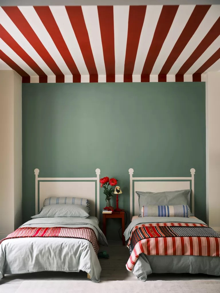 green twin bedroom with red and white painted ceiling