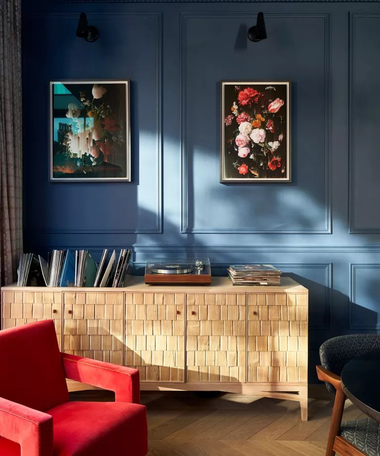 Living room with blue walls and wooden sideboard