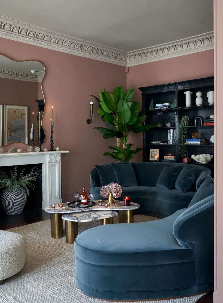 Pink living room with blue sofa