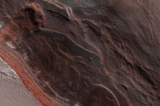 The HiRISE camera aboard NASA's Mars Reconnaissance Orbiter captured this image of an avalanche near the Red Planet's north pole on May 29, 2019.