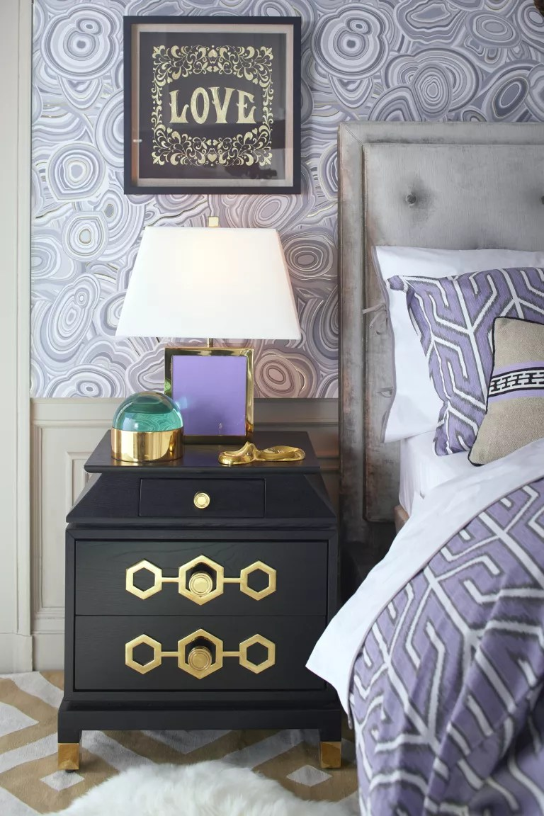 lavender bedroom with lavender wallpaper and bedding