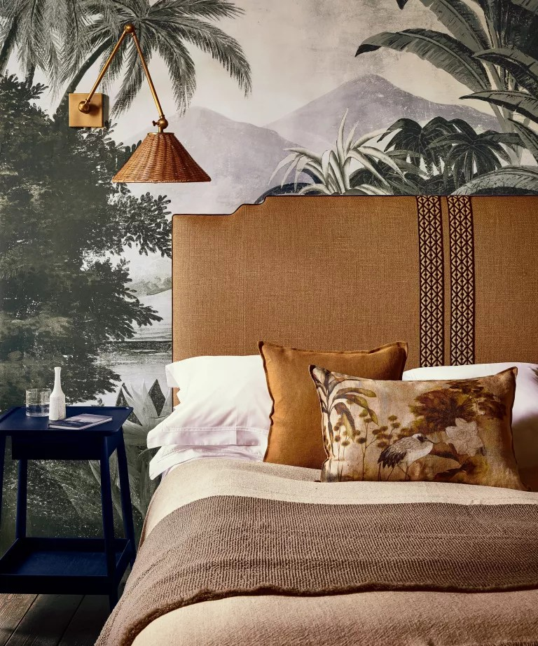 A bedroom color idea with wall mural and layers of tonal brown bedding and accessories