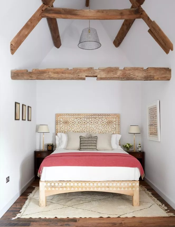 Havwoods bedroom with white walls and wood beams