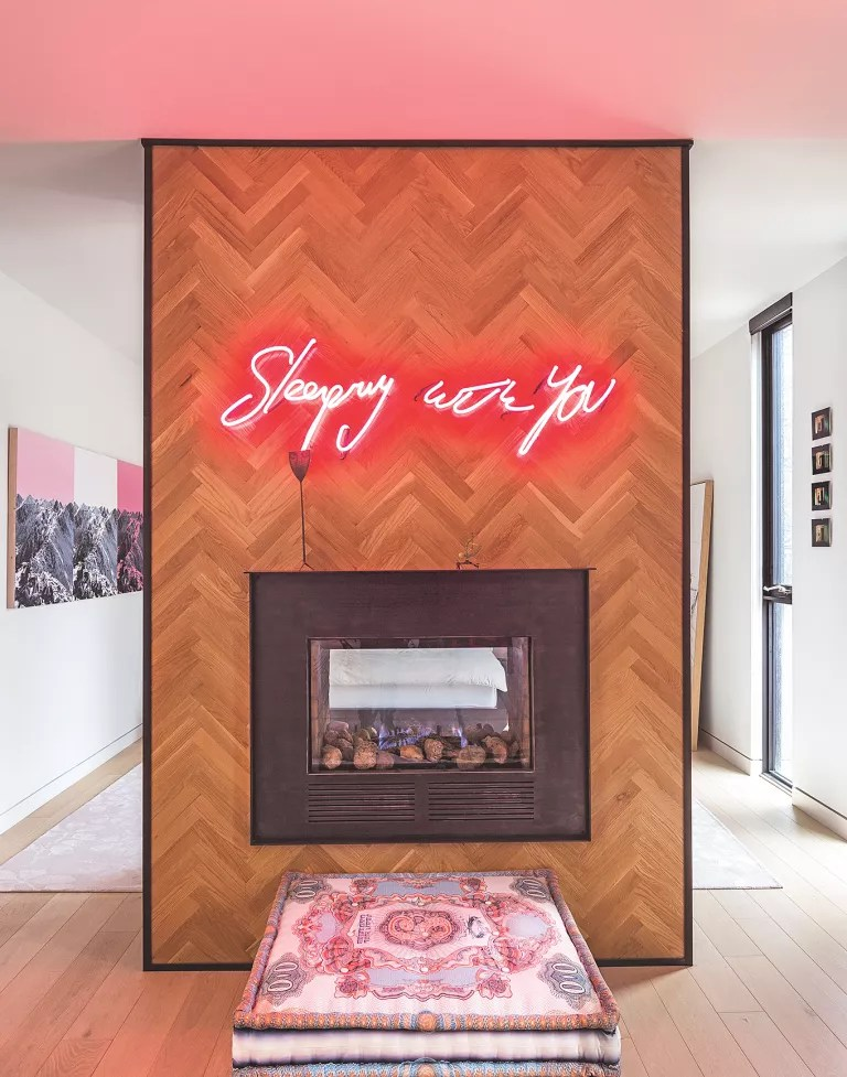 Fireplace with parquet flooring surround and neon light