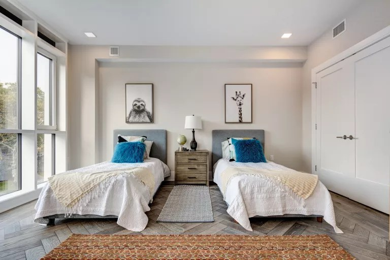 twin beds in neutral room