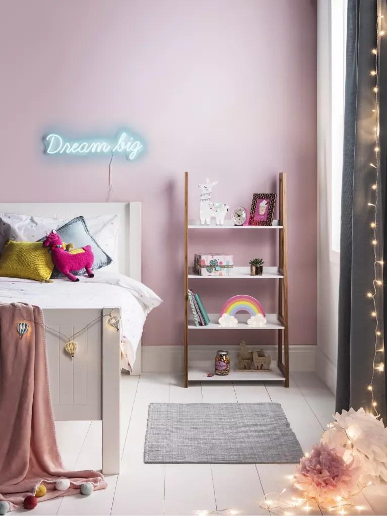Pink kids bedroom with neon lights