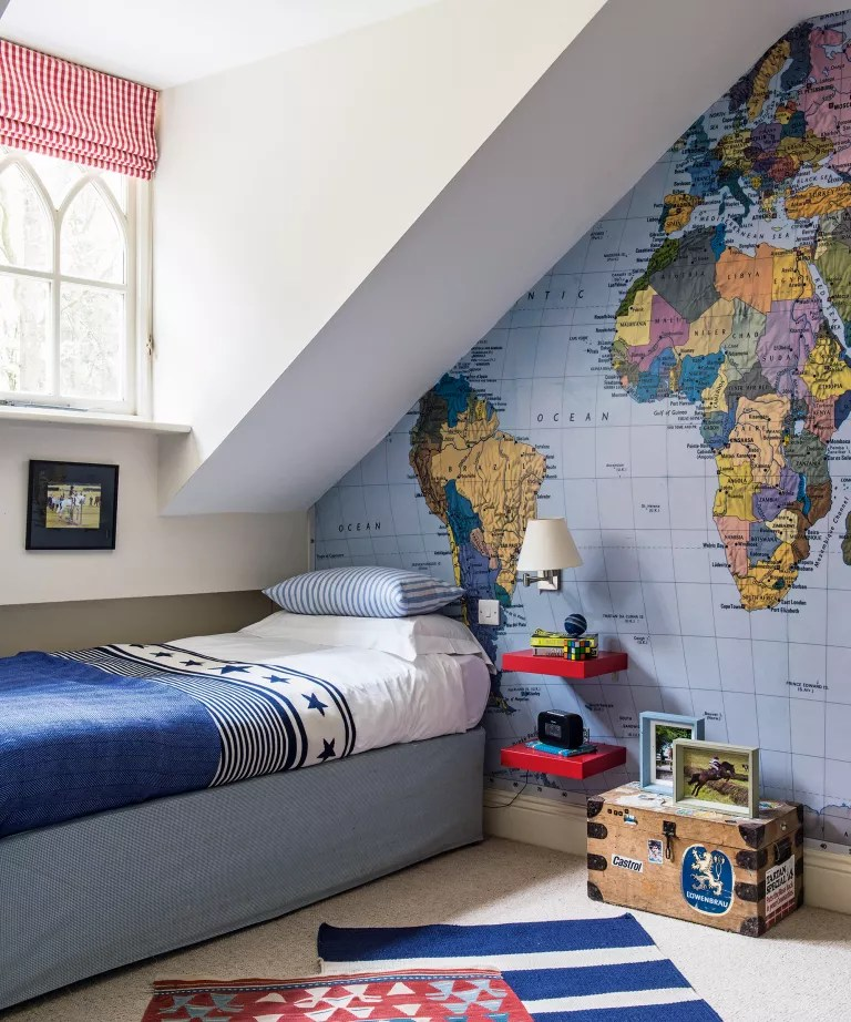 A child's bedroom with world map wallpaper