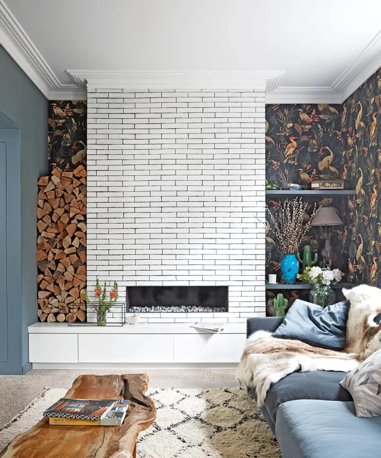 Bohemian living room ideas with brick fireplace and feature wallpaper