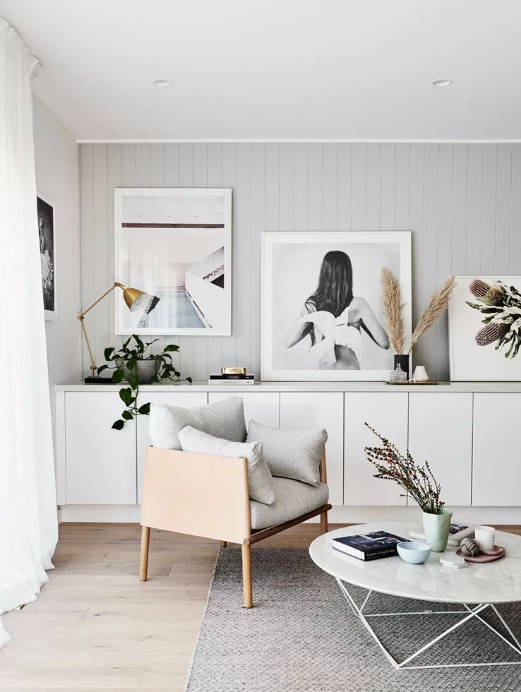 living room with wall panelling and sideboard