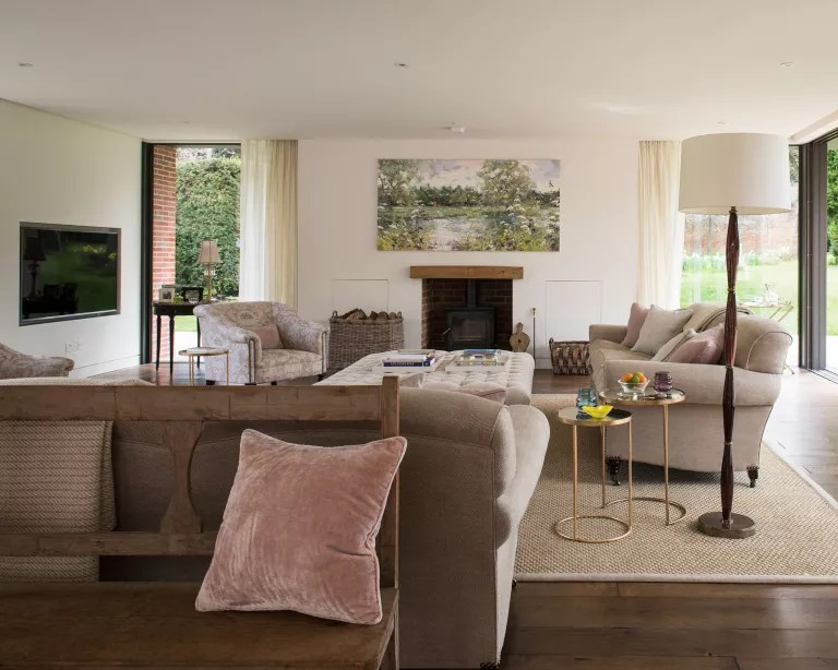 Open plan living room with neutral decor and wall mounted TV