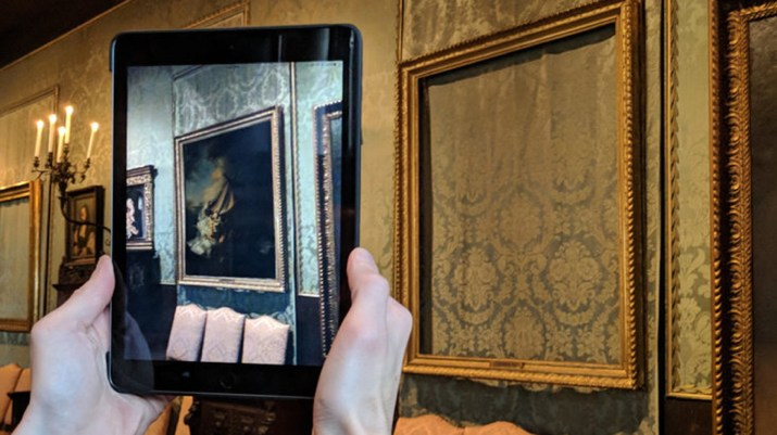 Image of a painting overlaid on a physical frame using augmented reality