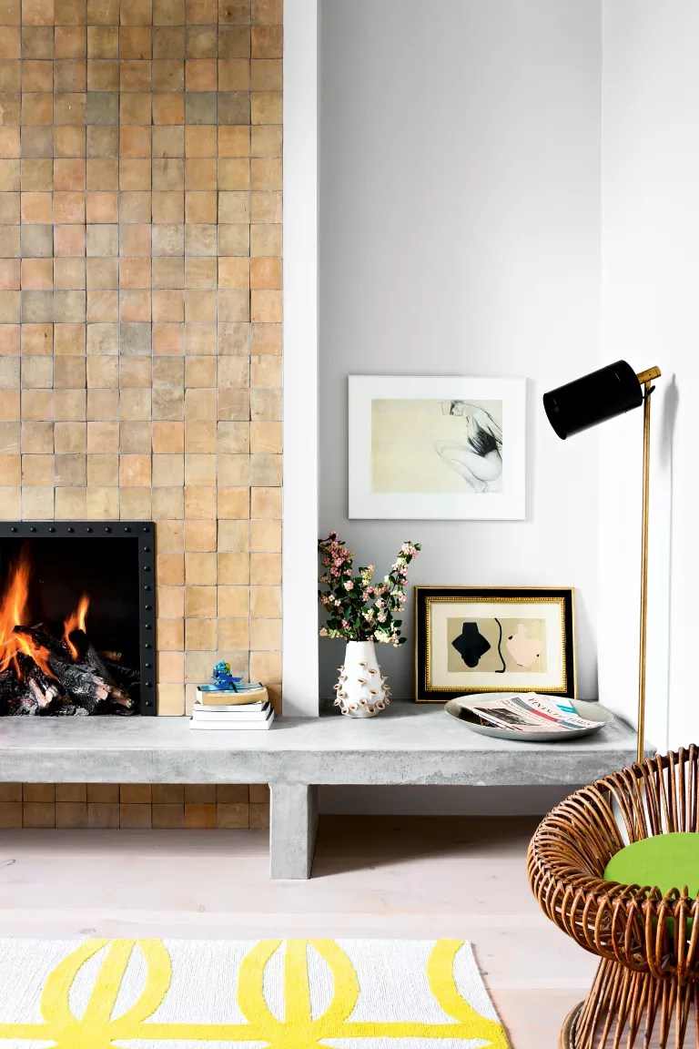 White living room with square tiled fireplace