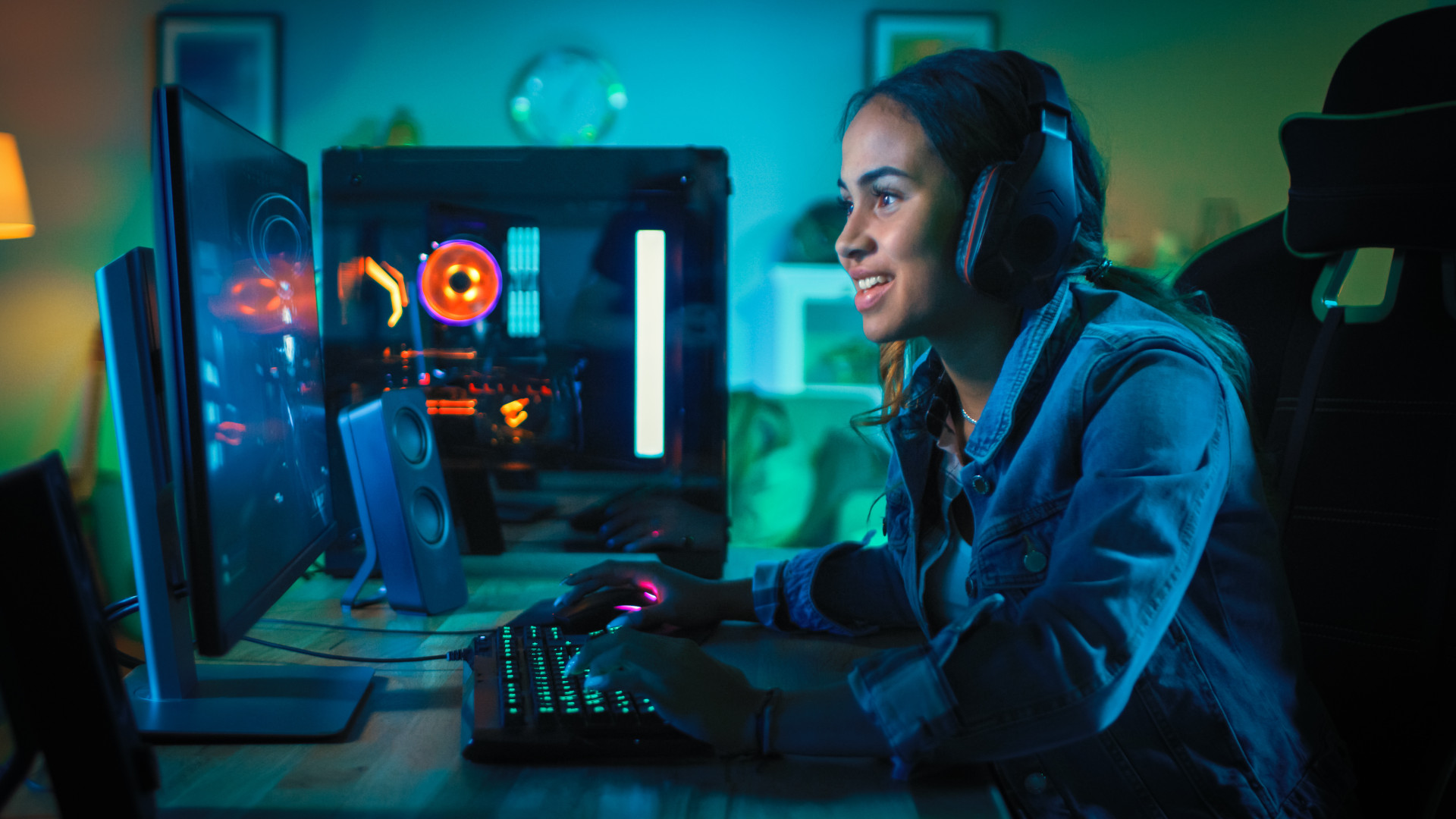 A woman playing games on a PC.