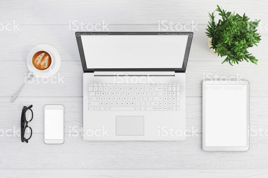 Blank laptop screen with phone and tablet