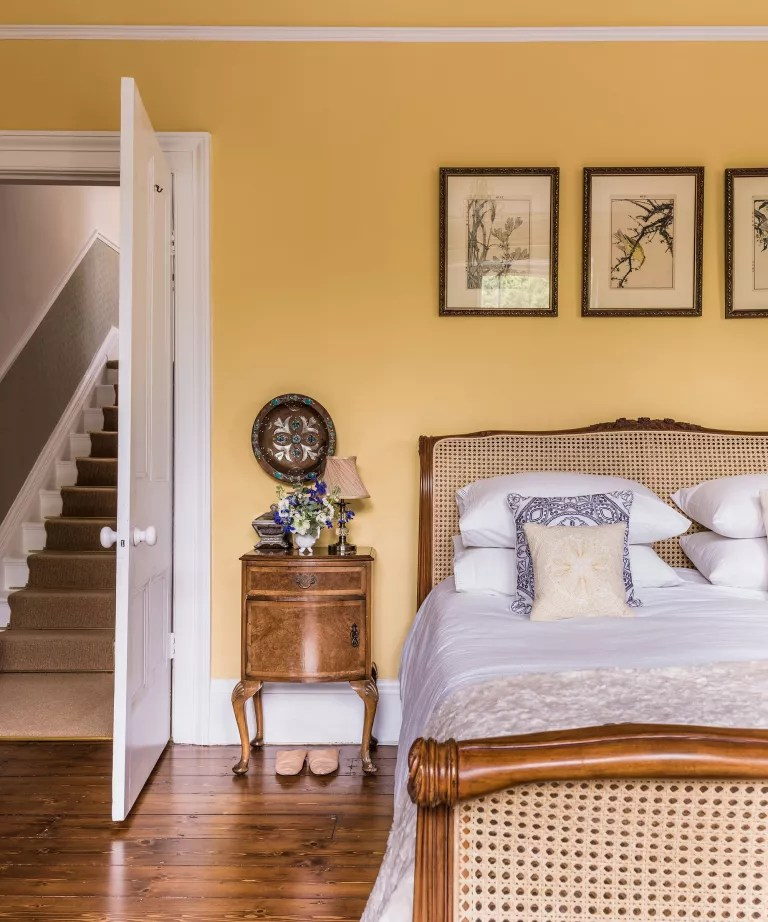 Bedroom accent wall ideas with yellow wall paint