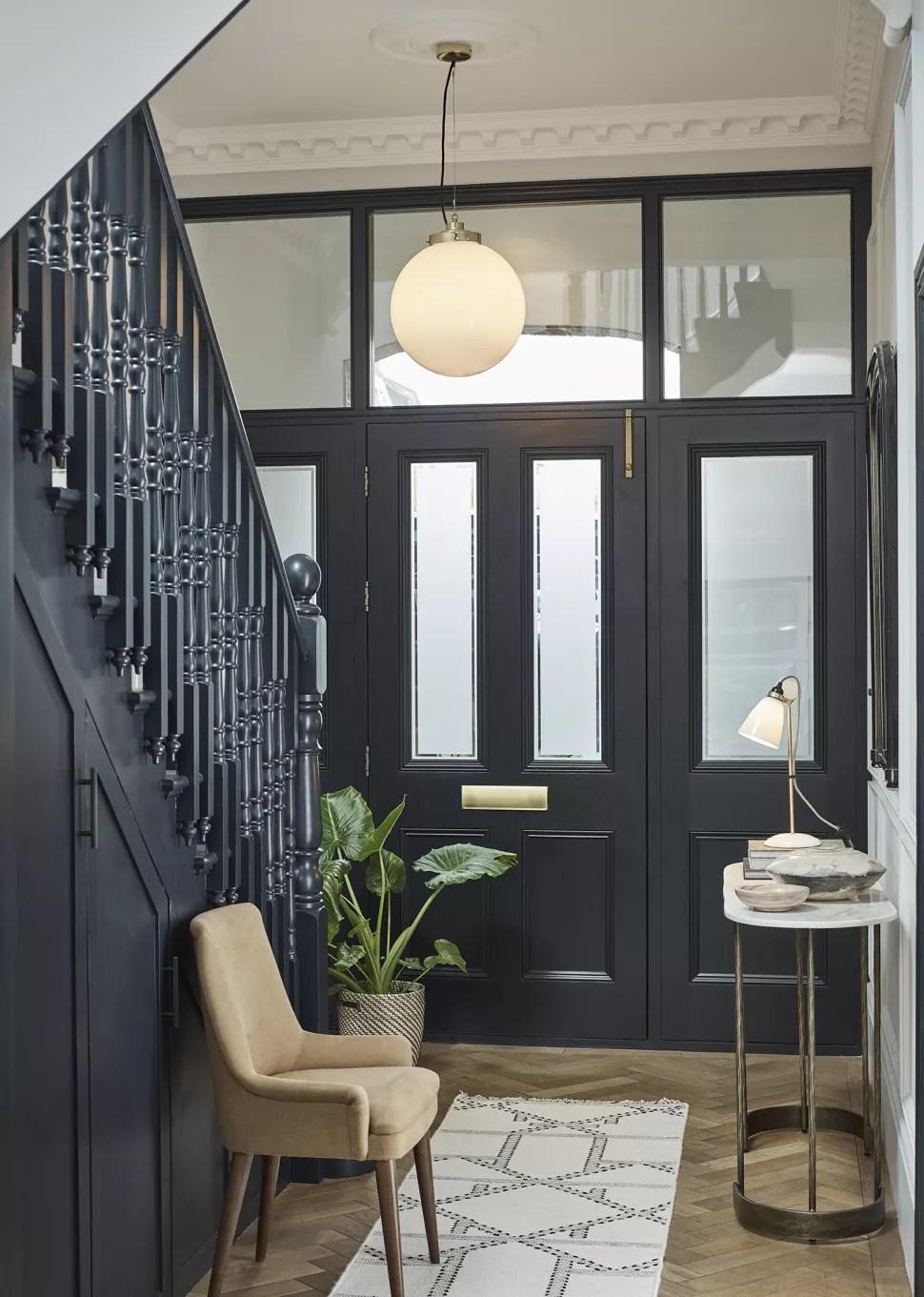 small hallway idea with glass panel front door
