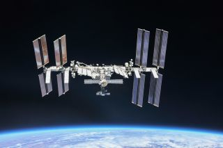 The International Space Station, photographed by Expedition 56 crewmembers from a Soyuz spacecraft in October 2018. NASA astronauts Andrew Feustel and Ricky Arnold and Roscosmos cosmonaut Oleg Artemyev executed a flyaround of the orbiting laboratory to take pictures of the station before returning home after spending 197 days in space.