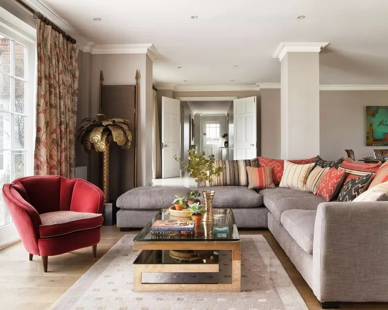 Living room with L-shaped sofa and red chair