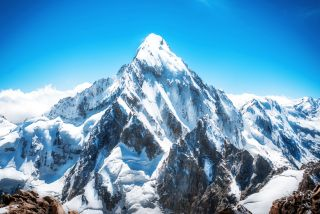 The peak of Mount Everest is the highest point in the world.