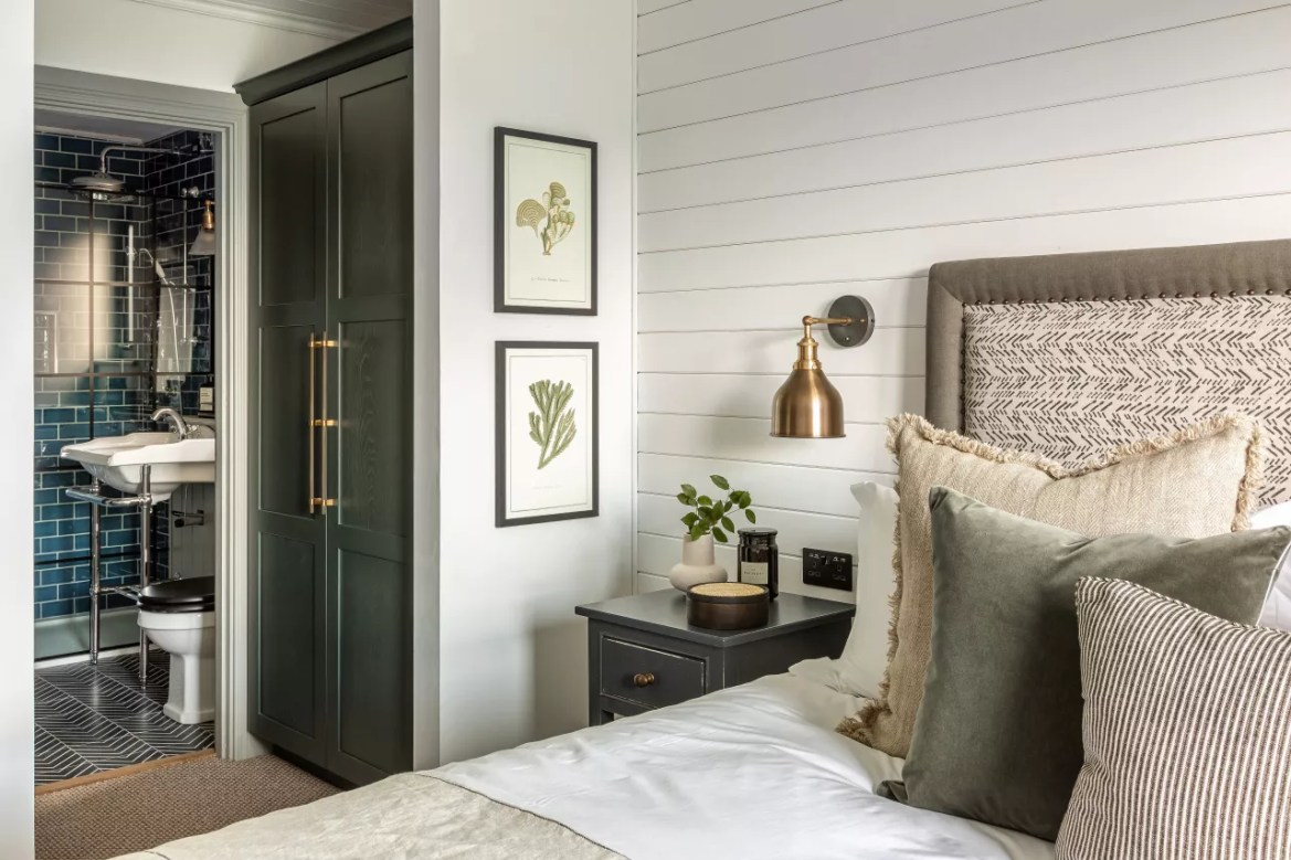 white bedroom with shiplap wall and ensuite bathroom