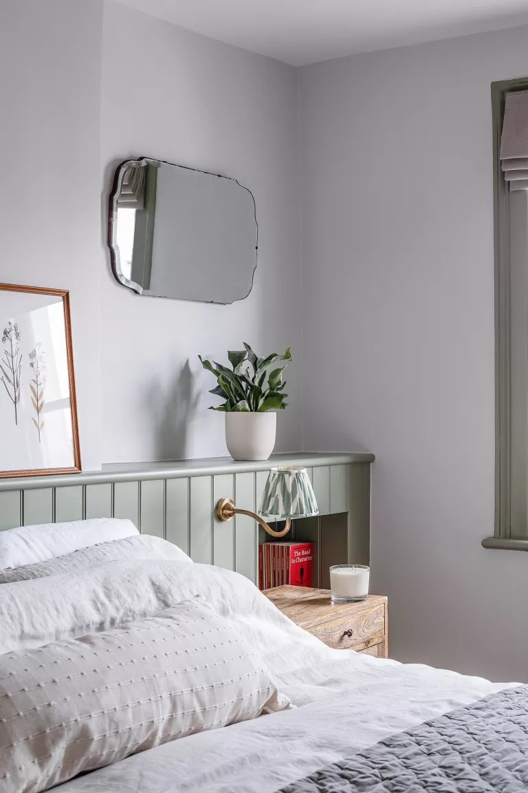 bedroom with shelf behind bed