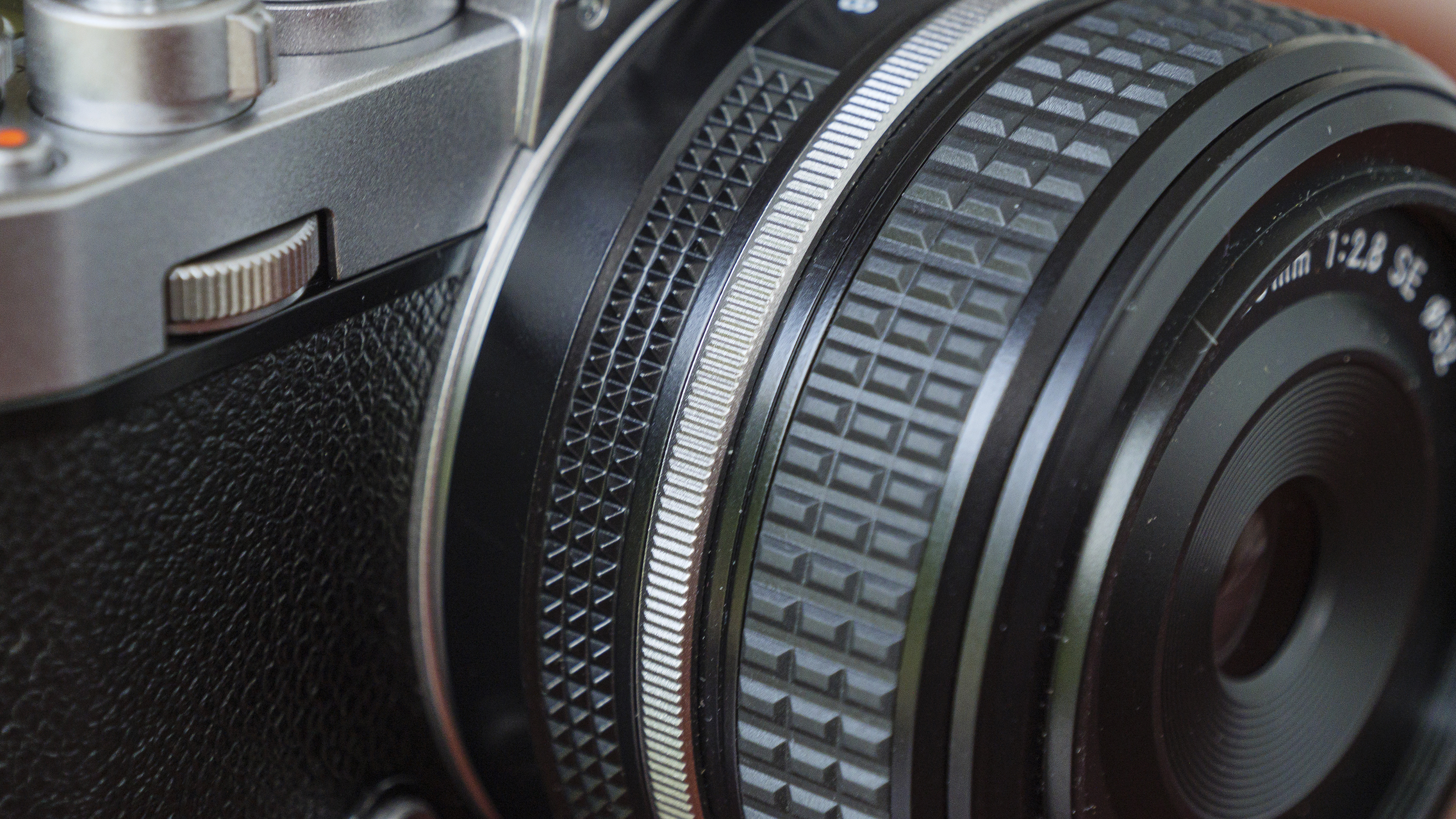 A close-up of a lens on the Nikon Zfc camera