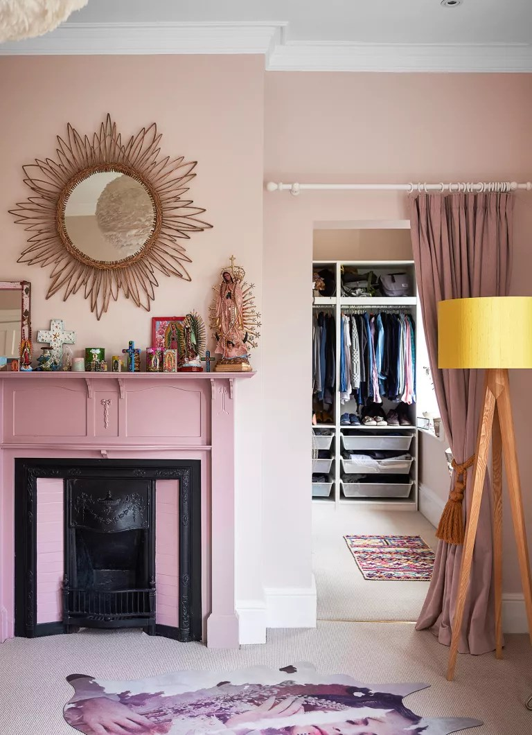Pink bedroom with fireplace and walk in closet