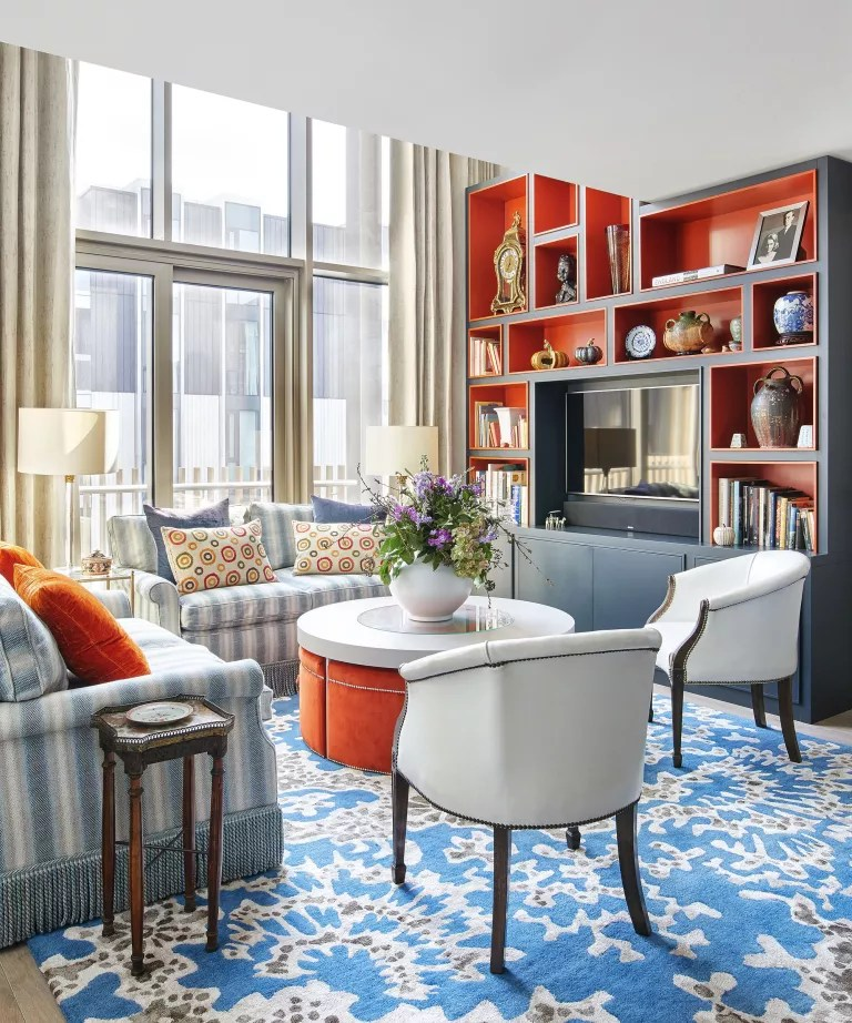 Living room with orange and blue shelves