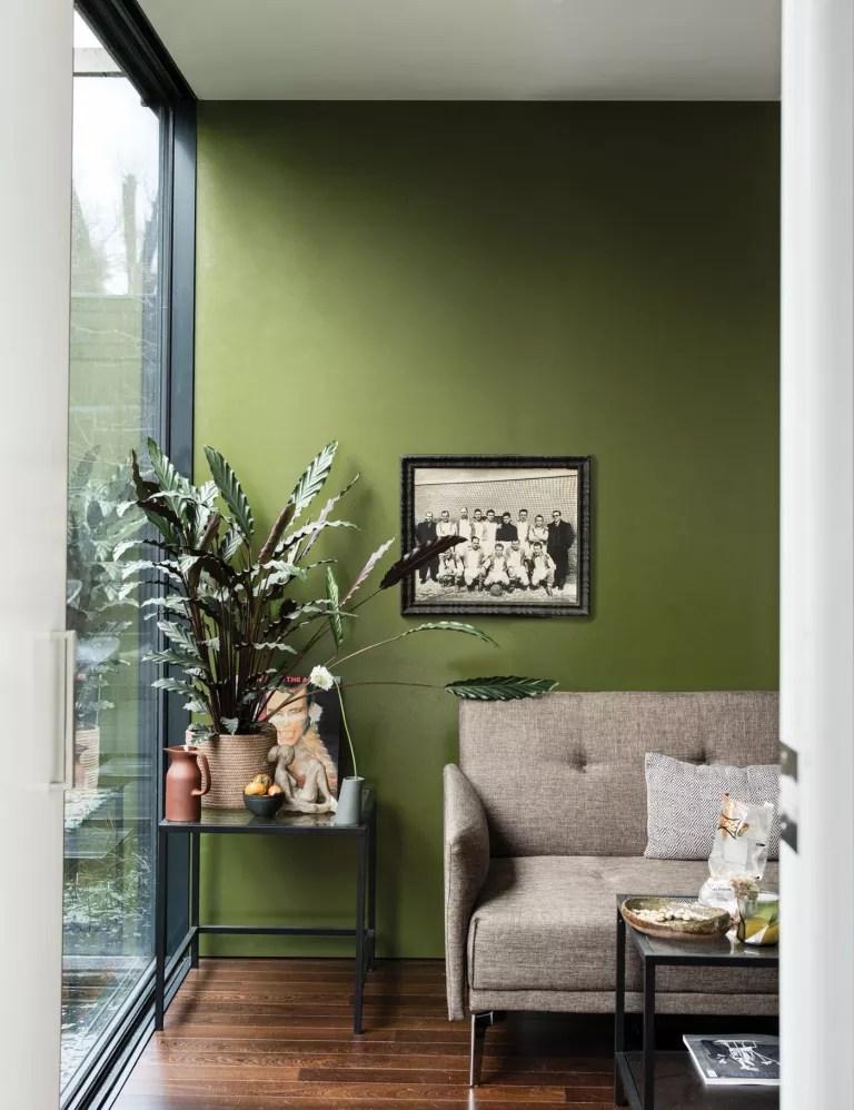 Green living room painted in Farrow & Ball Bancha