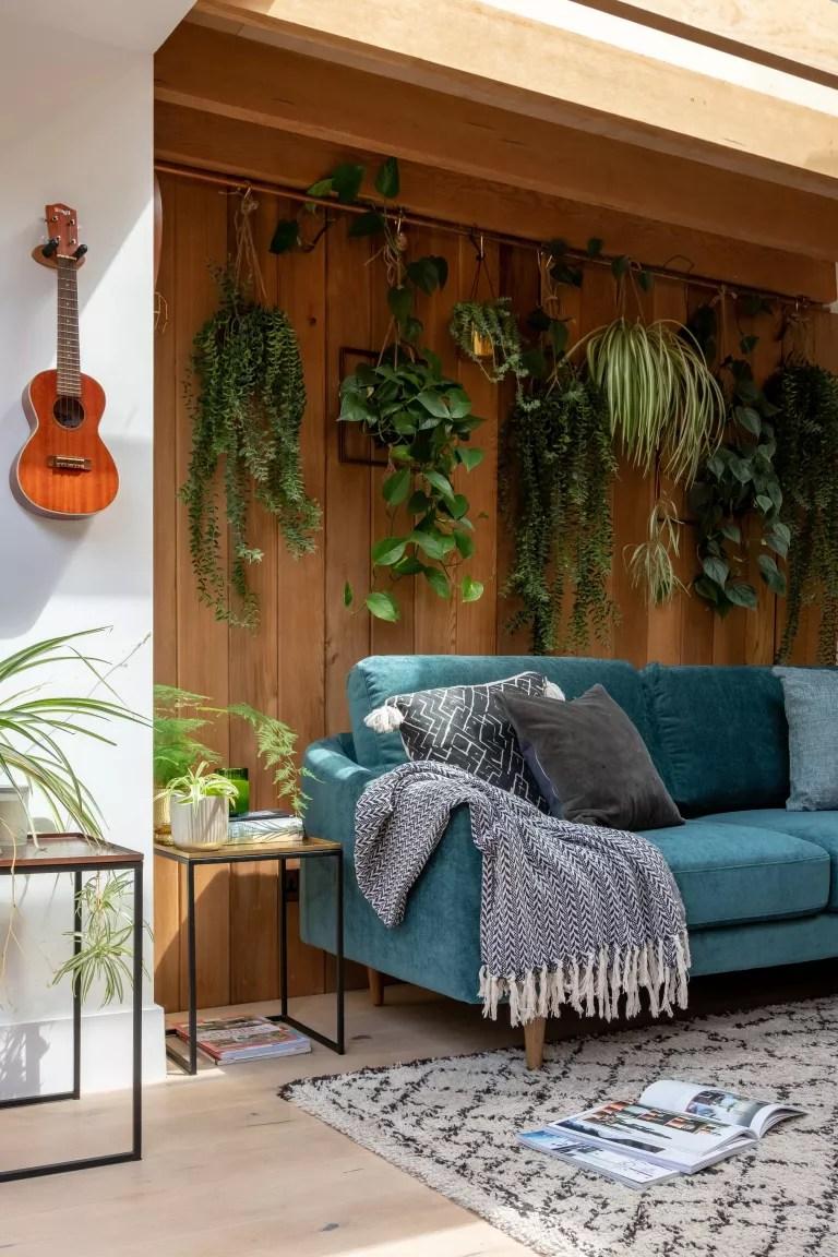 Blue sofa with grey cushions