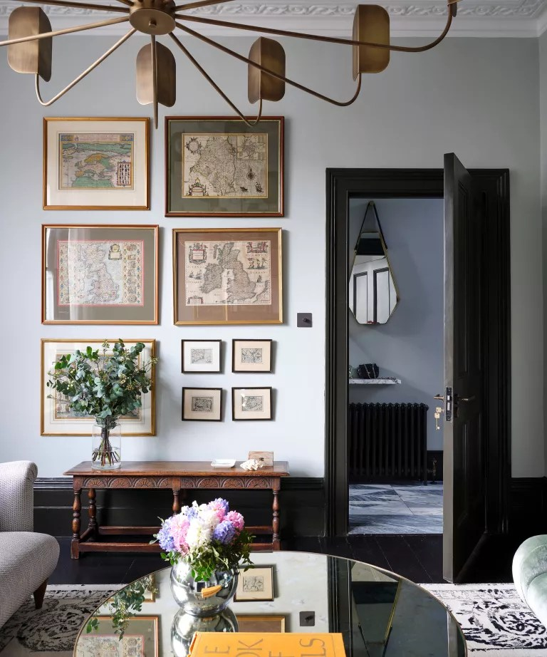 neutral living room with antique furniture and art