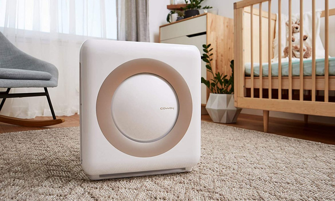 The Coway AP-1512HH Air Purifier in white, in a child's bedroom.