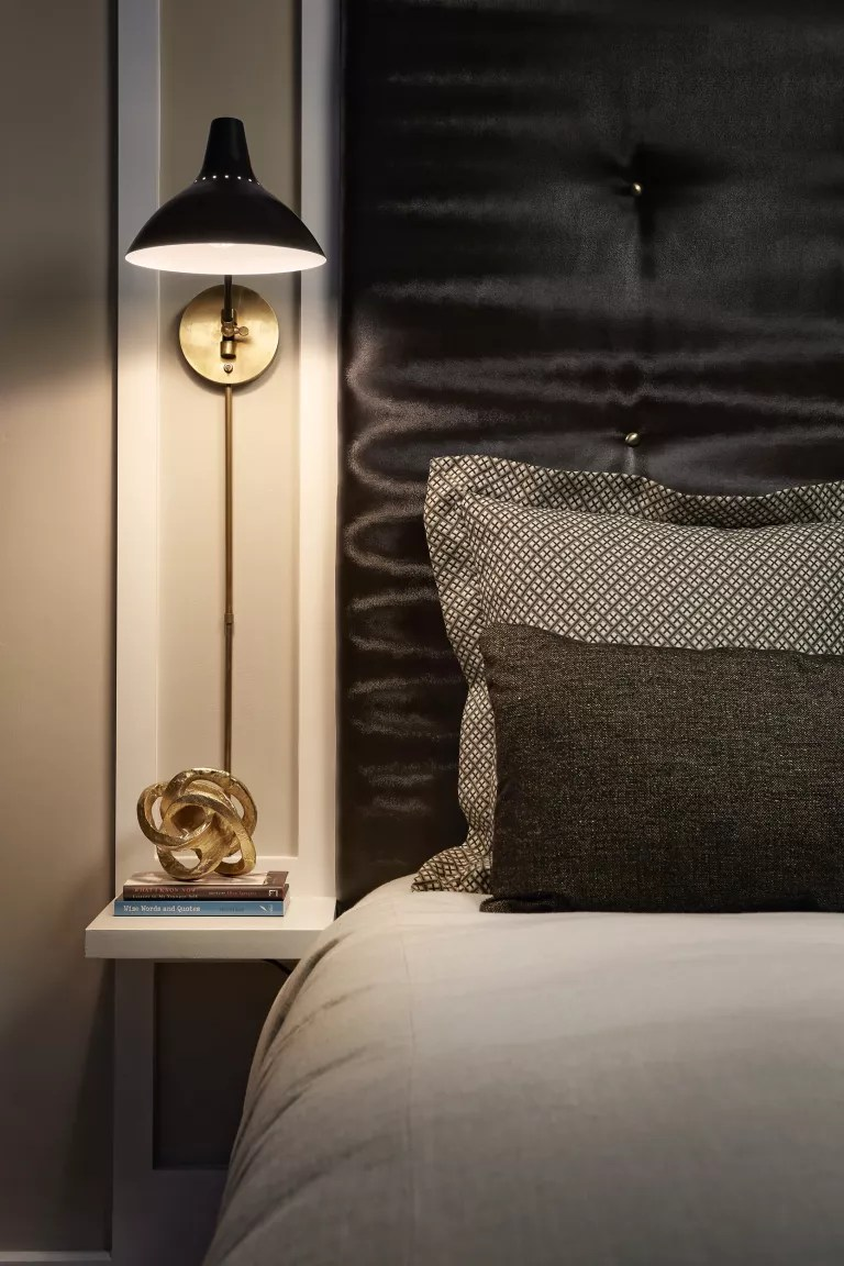 black and brass wall light in grey bedroom ideas for men, maestri studio