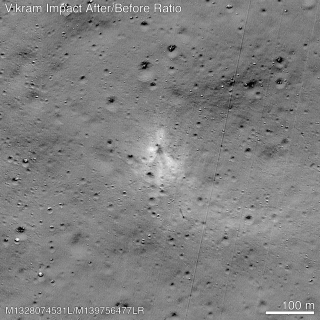 An image combining before and after photographs of the Vikram impact site highlights the dark inner and light outer materials splaying out from the impact. (The straight diagonal lines are imaging artifacts, not features on the moon.)