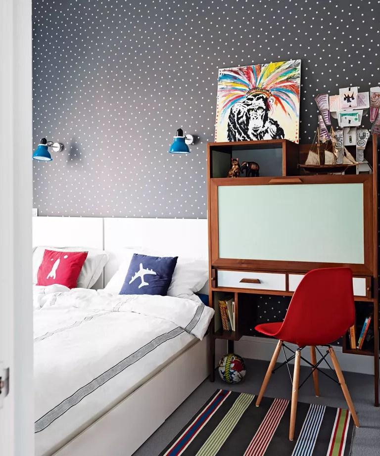Kids bedroom with grey wallpaper and storage desks